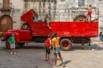 Red truck, children playing, Havana, Cuba 2013